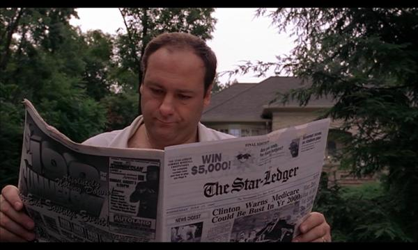 tony reading newspaper
